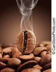 Closeup coffee bean with smoke on brown background