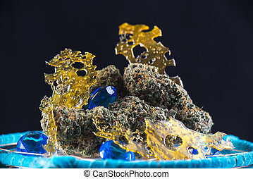 cannabis nugs and marijuana concentrates (aka shatter) with...