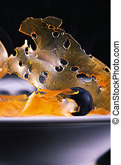 cannabis oil concentrate aka shatter against dark background