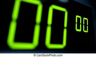 Macro digital watch counter timer. Green digit. - Close...