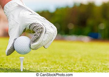 macro, disparando, mano, en, un, guante, y, pelota de golf