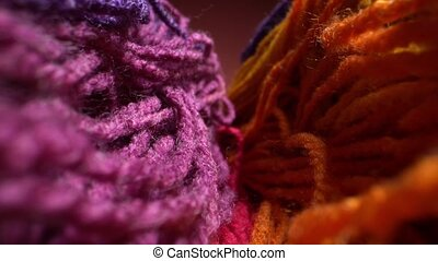Macro dolly shot a sliding footage of a beautiful colored wool yarn texture. May be used for background. Laowa probe lens