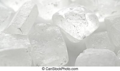Macro dolly shot of big white sugar crystals