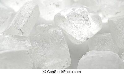 Macro dolly shot of big white sugar crystals