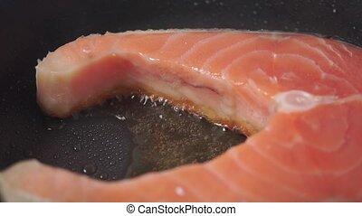 Macro dolly shot of frizzling salmon steak clip