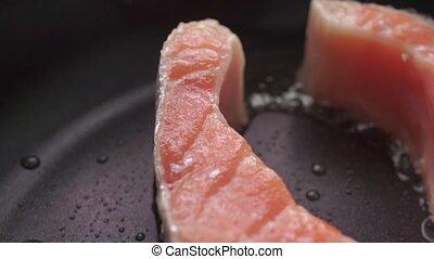 Macro dolly video of frizzling salmon steak clip