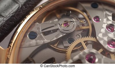 Macro dolly video of wrist watch mechanism clip