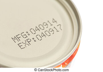 Macro expiration date on canned food isolated on white...