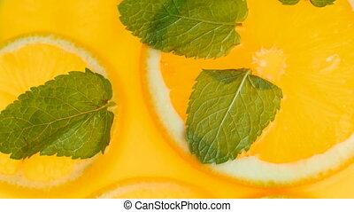 Macro footage from top view of fresh lemonade with mint and...