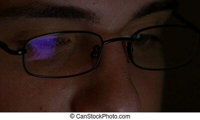 Macro footage of businessman eyes while browsing social...