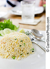 Macro Fried rice thai style on white plate .