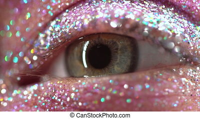 Macro green female eye with glitter eyeshadow, colorful...