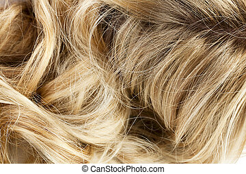 Macro image of a blond wavy hair of a woman