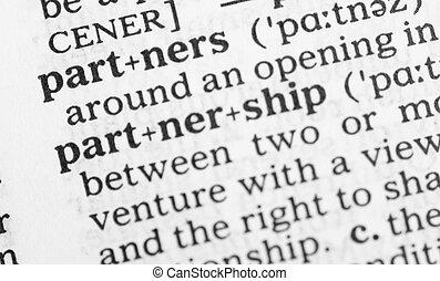 Macro image of dictionary definition of partnership - Macro...
