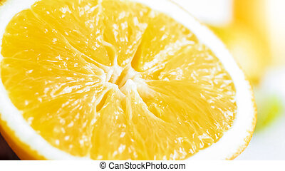 Macro image of freshly cut orange over white background