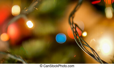 Macro image of LED Christmas lights garland hanging on Xmas tree