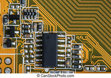 macro microchip in yellow circuit board abstract background