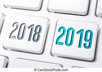 Macro Of 2 Buttons With The Year 2018 And 2019 On White Keyboard