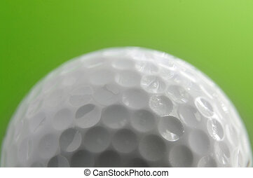 macro of a golf ball on green