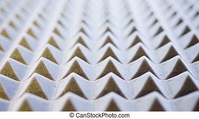 Macro of acoustic foam panel background, sliding video,...