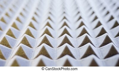 Macro of acoustic foam panel background, sliding video, shallow depth of field