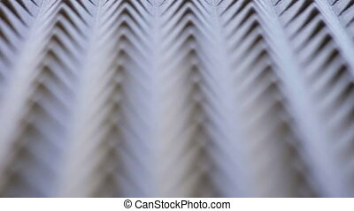 Macro of acoustic foam panel background, sliding video, shallow depth of field, textured motion background