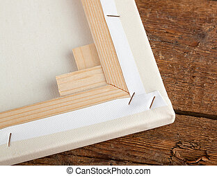 Macro of an artist canvas on wooden table