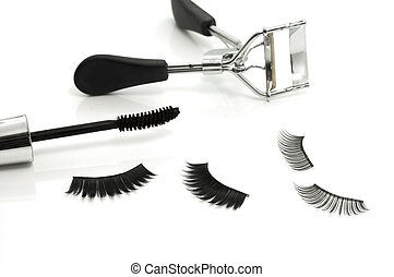 eyelash curler, mascara and false eyelashes - Macro of ...