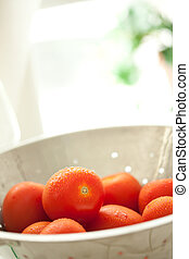 Fresh, Vibrant Roma Tomatoes in Colander with Water Drops - ...