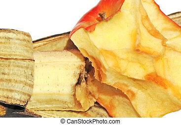 Macro of half eaten, rotting apple and banana, shallow dof, on white