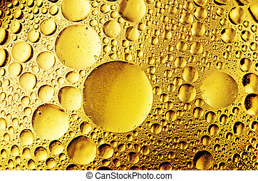 macro of oil drops on the water