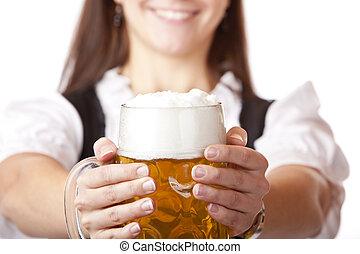 Macro of Oktoberfest beer stein held by woman - /Closeup...