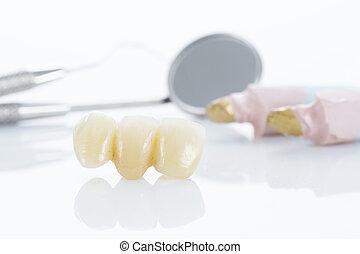 Macro of prosthetic teeth with dental tools