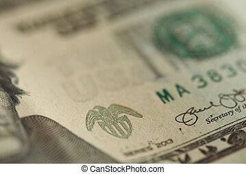 Macro of stamp on dollar banknote