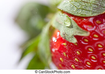 Macro of Fresh Strawberry and Water Drop.