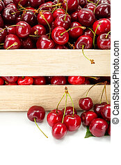 Macro of sweet cherries (Prunus avium) in wooden crate