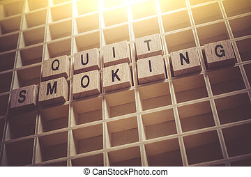 Macro Of The Words Quit Smoking Formed By Wooden Blocks In A Typecase