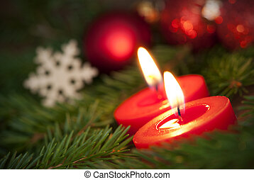 Macro of two Burning Candles with Christmas Background - ...