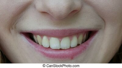 Macro of woman beautiful mouth wide smile