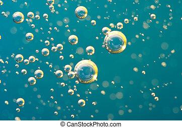 Macro Oxygen bubbles in water on blue background