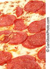 bubbling thin crust pepperoni pie macro focus on top