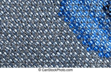 Macro photo of blue and gray beadwork. - Macro photo of blue...