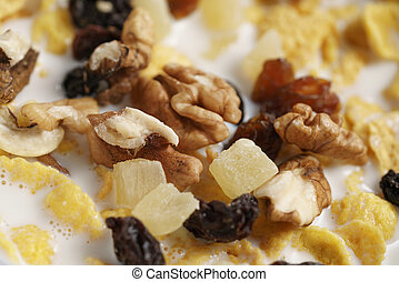 macro photo of corn flakes with fruits and nuts in bowl