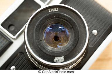 Macro photo of manual lens for retro camera with iris aperture