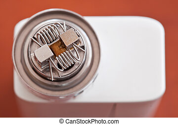 Macro photo of new clapton coil mounted in the electronic cigarette