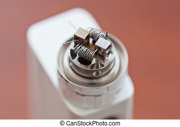 Macro photo of new twisted coil mounted in the electronic cigarette