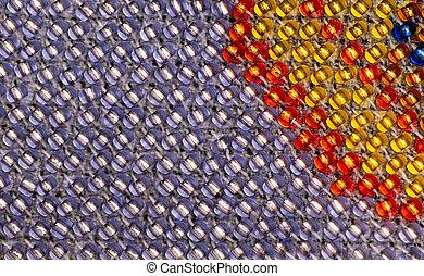 Macro photo of purple and red beadwork. - Macro photo of ...