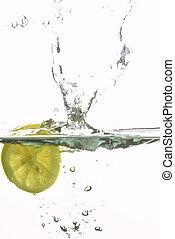 lemon splashing water - macro picture of fresh lemon ...
