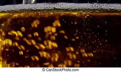 Macro plan of beer with bubbles