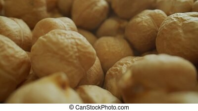 Macro probe shot of dried chickpeas. Shot on a cinema camera.